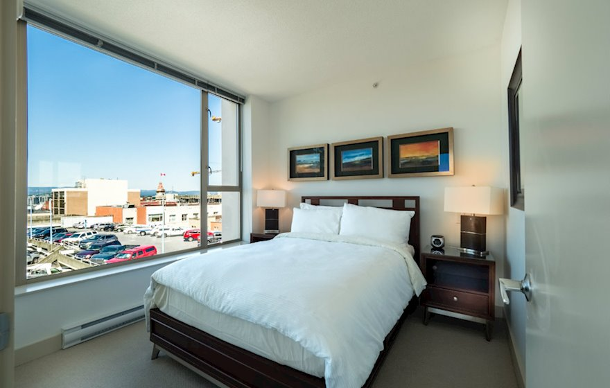 Second bedroom queen bed fully furnished apartment suite 702 Victoria