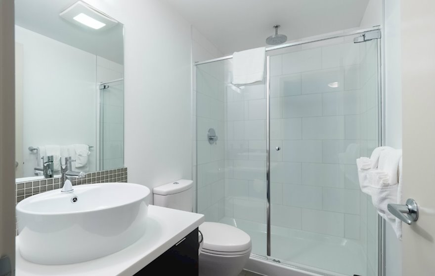 Bathroom walk in shower fully furnished apartment suite 702 Victoria