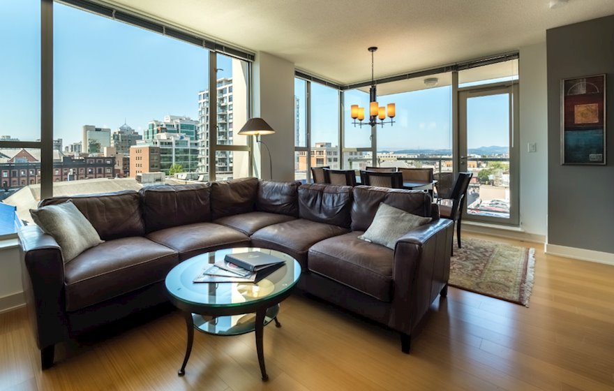 Living room dining room fully furnished apartment suite 702 Victoria
