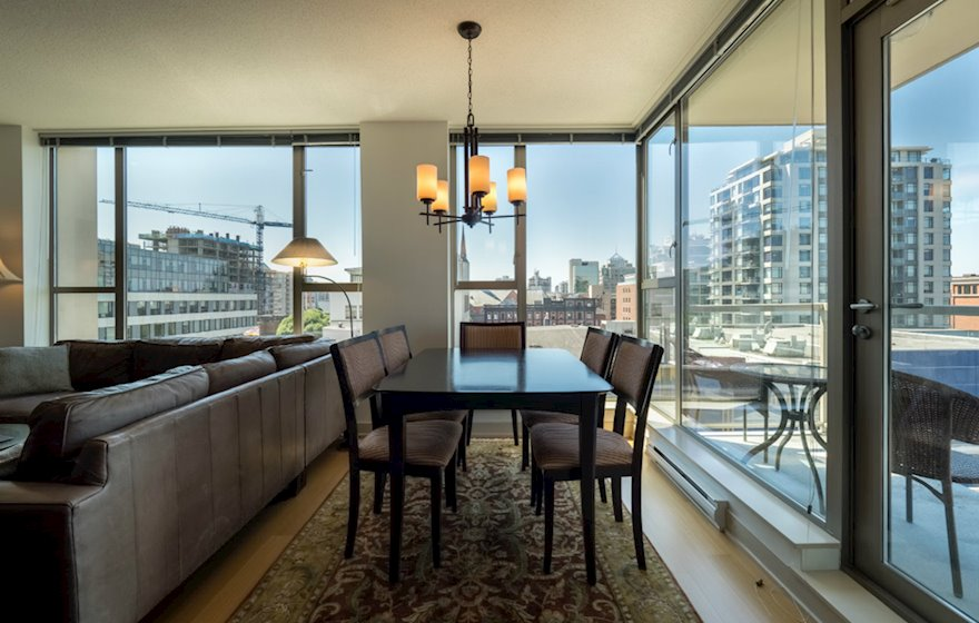 Dining room with a view fully furnished apartment suite 702 Victoria